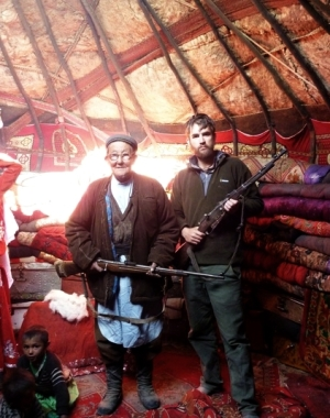 Jack standing with a local in Afghanistan.