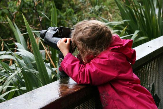 Ruby, looking through binoculars backwards.