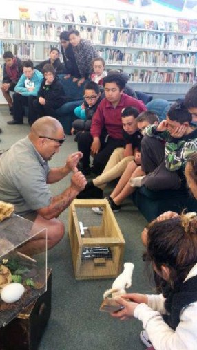 Ranger Joe showing Tolaga Bay School kids how traps work.