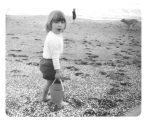 Elizabeth as a child at the beach.