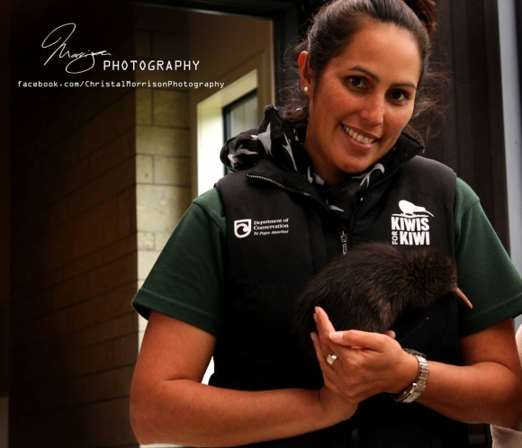 Renee holding a kiwi before a release at Wairakei Sanctuary. Photo: Christal Morrison.