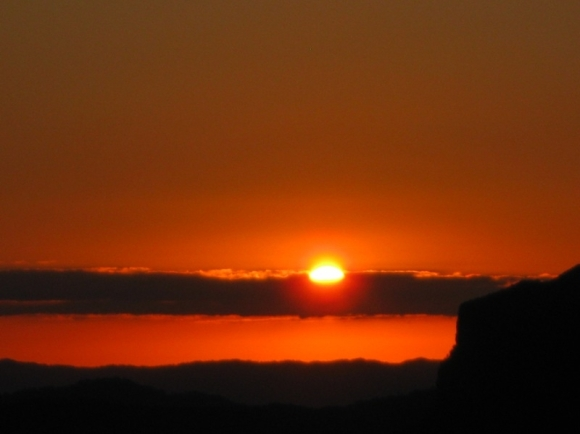 An orange sunset from the top of The Pinnacles.