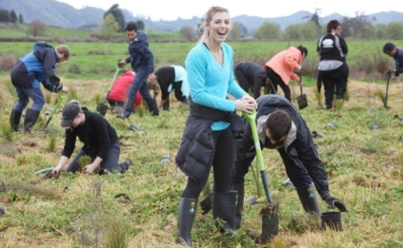 Fonterra staff out planting trees at Lake Areare.