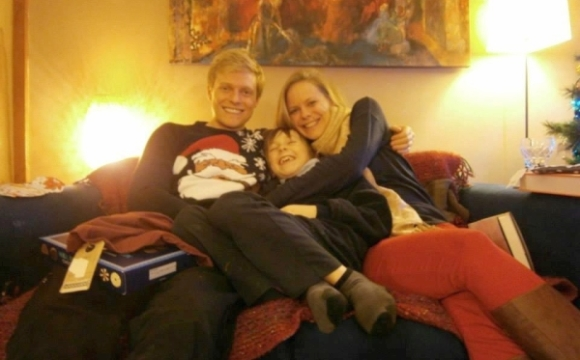 Rose with her two brothers, Charlie and Finn on a couch.