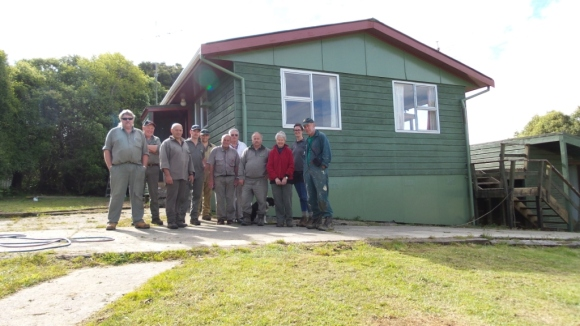 Volunteers and DOC staff standing in front of the finished house.