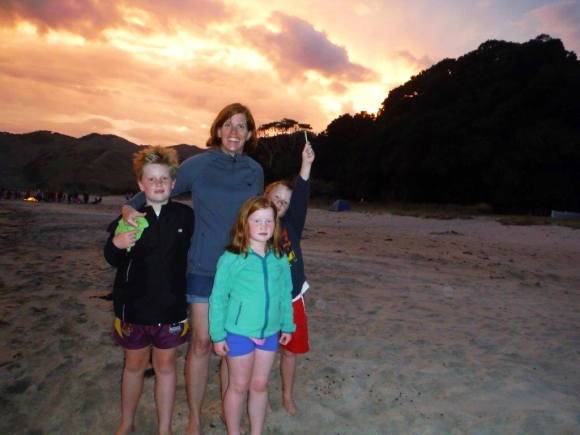 Nina Mercer and her children at Anaura Bay at sunset.