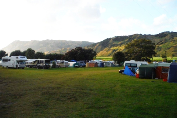 Tents and caravans at Anaura Bay campsite in the early morning.