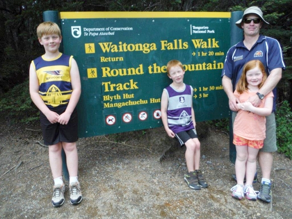 Nina's family standing in front of the Waitonga Falls Walk sign.