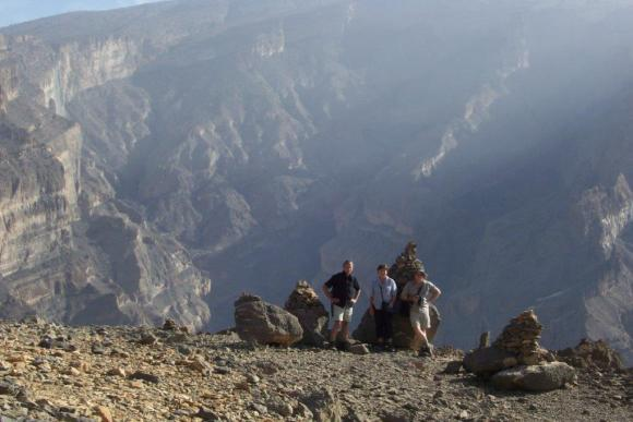 Terry and his family in front of mountains in Oman.