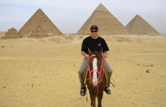 Simon in Egypt on horseback in front of the pyramids.