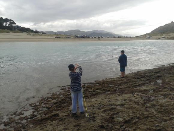 Fishing at Deliverance Cove, Castlepoint.