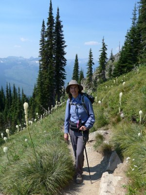 Sally in her walking gear standing on a track in Glacier National Park, Montana.