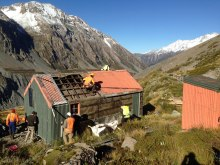 Historic Hooker Hut being dismantled.