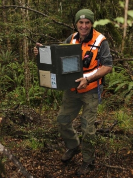 DOC Rranger Malcom Swanney with a kiwi carry case. Photo: Nina Mercer.