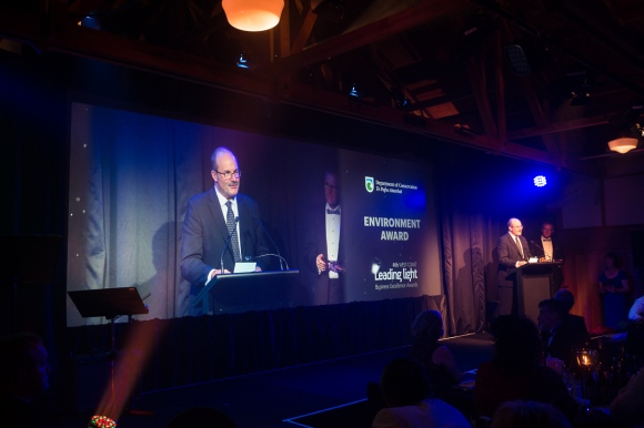 DOC Director-General presenting at the Leading Light business awards.