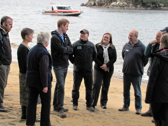 Prince Harry with Brent Beaven (far left) and Ulva Island Trustees. Photo: Andrea Crawford | DOC.