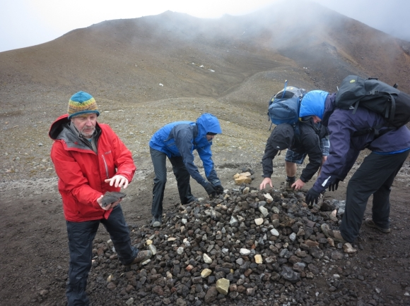 Harry and other DOC staff dismantling a cairn (rock pike) on the Tongariro Crossing.