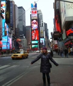 Chloe Barnes standing in Times Square, New York.