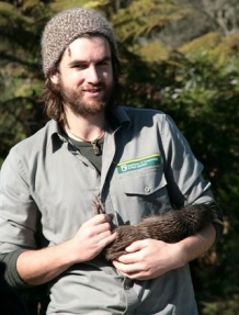 Jack Mace holding a kiwi.