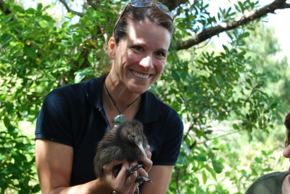 Michelle Impey holding a kiwi.