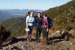 Caroline Hodges, Oonagh Daly and Moyang Li enjoying the view – Mt Stevens snail plots, Takaka. Photo DOC.