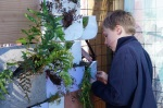 Student planting at the Urban Living Wall.