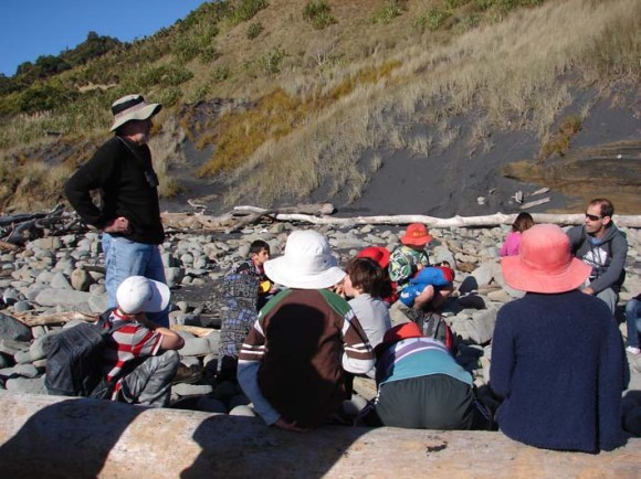 Students learning about coastal plants from Whanganui botanist Colin Ogle.