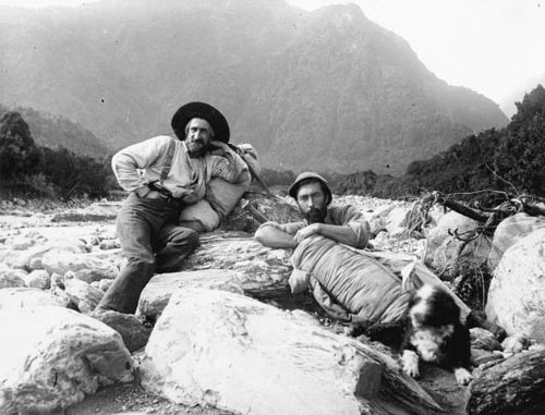 C. Douglas (left),A. Harper and dog Betsey Jane, rest in the Cook River Valley in 1894. Photo: Arthur Paul Harper | Alexander Turnbull Library.