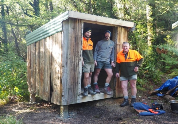 The completed woodshed with DOC staff Dave Titchener, Jason Lange and Joe Hansen.