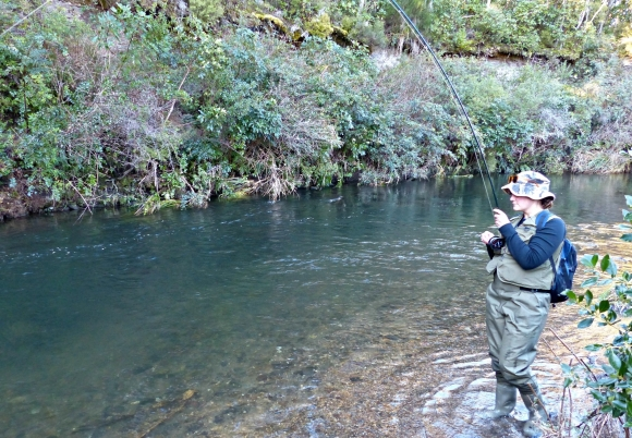 Evelien reeling in the trout.