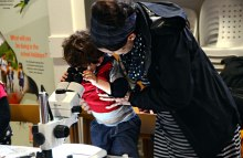 Luke and Mary Jane Smith take a turn at working the microscope.