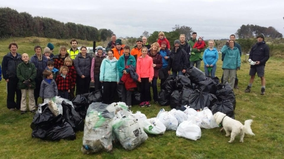 Beach clean-up volunteers with the rubbish they collected at Waitara West.