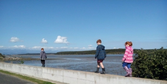 Three children going for a wander at the Manawatu Estuary.