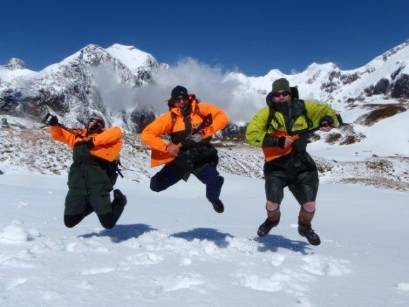 Pania and other rangers playing air guitar on the Mackinnon Pass.