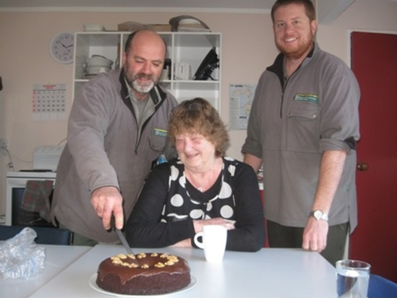 DOC staff cutting a cake at the Chatham Islands Office.