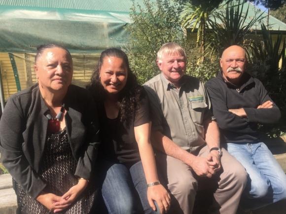 DOC staff wiith Ngāti Whare representatives.