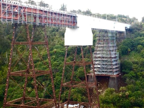 Makatote Viaduct wrapped in plastic while painting work is carried out.