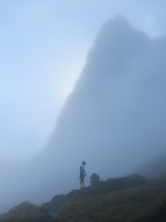 Matt Jenke and the Google Trekker equipment in the mist on the Milford Track. Photo: Peter Hiemstra.