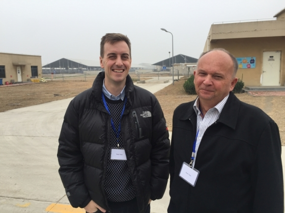 Fonterra's Alex Worker with DOC's Bruce McKinlay at Yutian Farm.