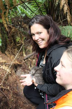 Arna releasing a kiwi chick. Photo: Sian Moffitt.
