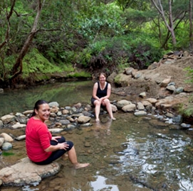 Relaxing in the hot pools on Great Barrier Island. Photo: © Andris Apse.
