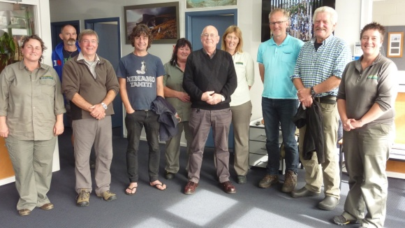 Doug (centre) with DOC Invercargill colleagues.