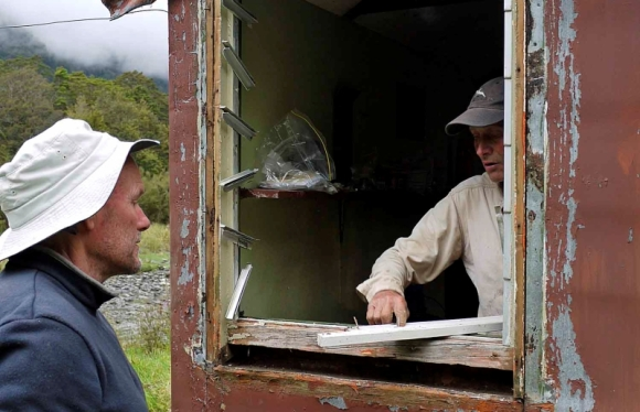 Hugh van Noorden and Peter Fullerton replacing a rotten windowsill at Tunnel Creek Hut.