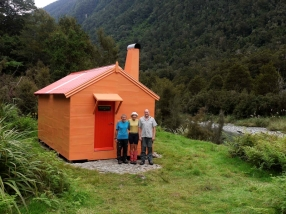Geoff, Liz and Hugh outside the restored Tunnel Creek Hut, 2015.