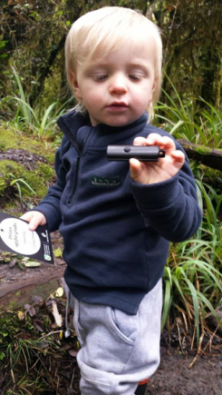 Corban finding the geocache.