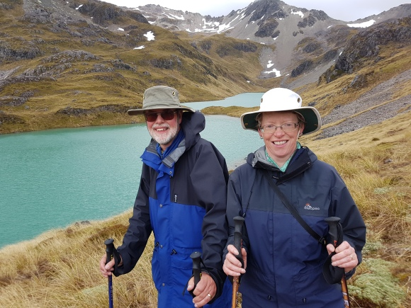 Chris and Viv Shaw. The Hinepouri tarns in the background are bright blue because of the Kaikoura earthquake.