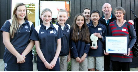 Teachers Collette Taylor and Alan Murphy, and students accepting their conservation award.