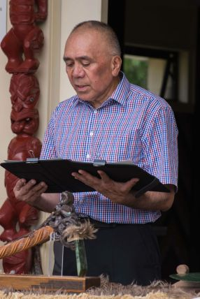 Heamana Tamehana Manaena reads from Maungaharuru-Tangitū's treaty gifting back their lands to Aotearoa. Photo: Lauren Buchholz