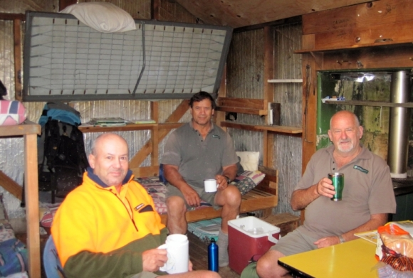 Sharing a cuppa with colleagues in a DOC hut.