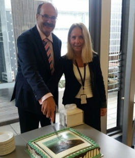 Cutting the cake at our National Office celebration with Annie Wheeler.